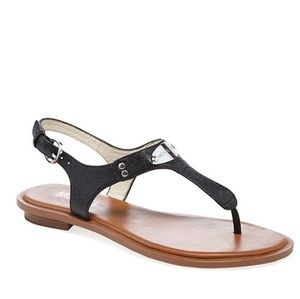 Michael kors plate thong sandals.